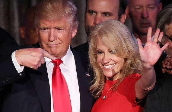 Donald Trump and Kellyanne Conway together at an event. Trump is pointing fingers at her as a symbol of praising. Recently Donald Trump seems to put Kellyanne Conway's husband George Conway's name forward for US Solicitor General.