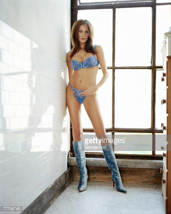 Melania Trump wearing sexy blue bra and underwear with long boots.