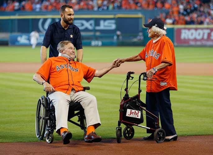 Papa Bush and Barbara Bush holding hand. 72 years of marriage and they are still in love as they first met.