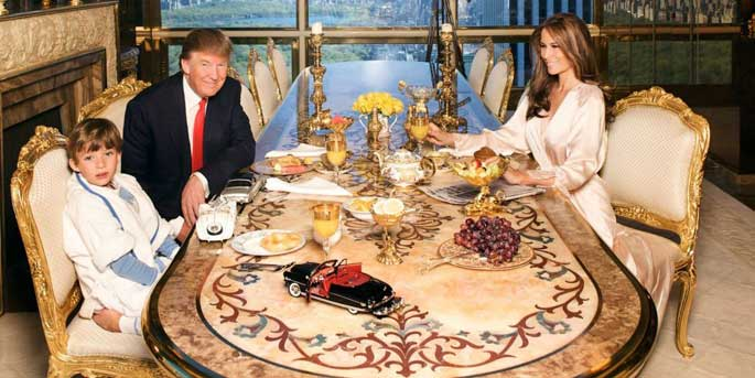 Barron Trump dining with his father Donald and mother Melania in fancy looking table and chair.