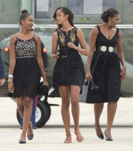 First lady Michelle Obama, right, and her daughters Sasha, left, and Malia.
