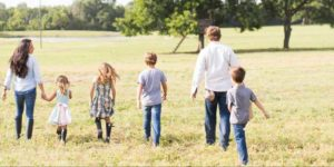 Gaines Family with children walking in their 40 acres farm.