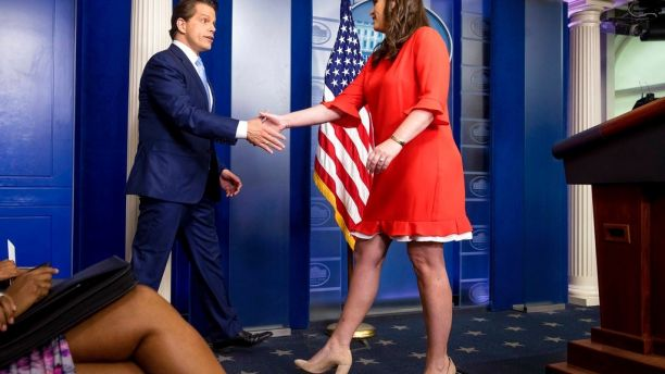 Sarah Huckabee shaking hand with Anthony Scaramucci in White House.
