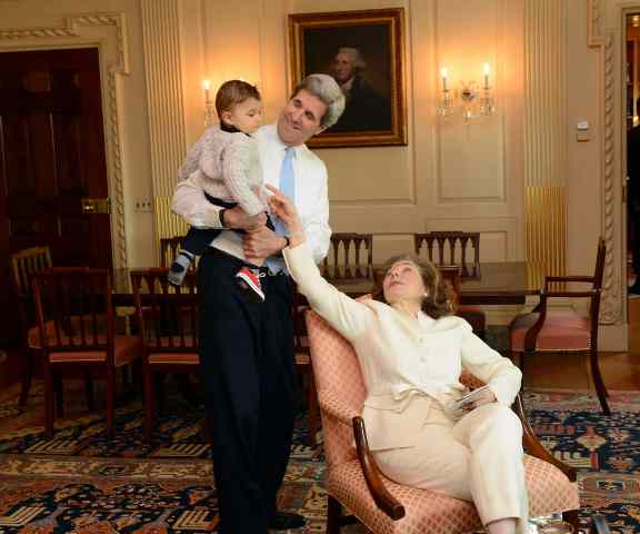 John Kerry and his wife with their grandson.